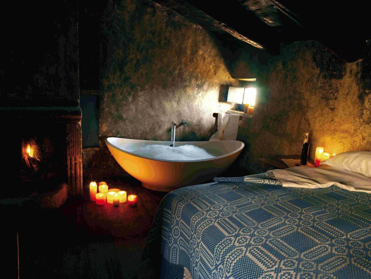 The rustic charm and intimacy of the rooms at Sextantio Albergo Diffuso offer guests a truly authentic experience