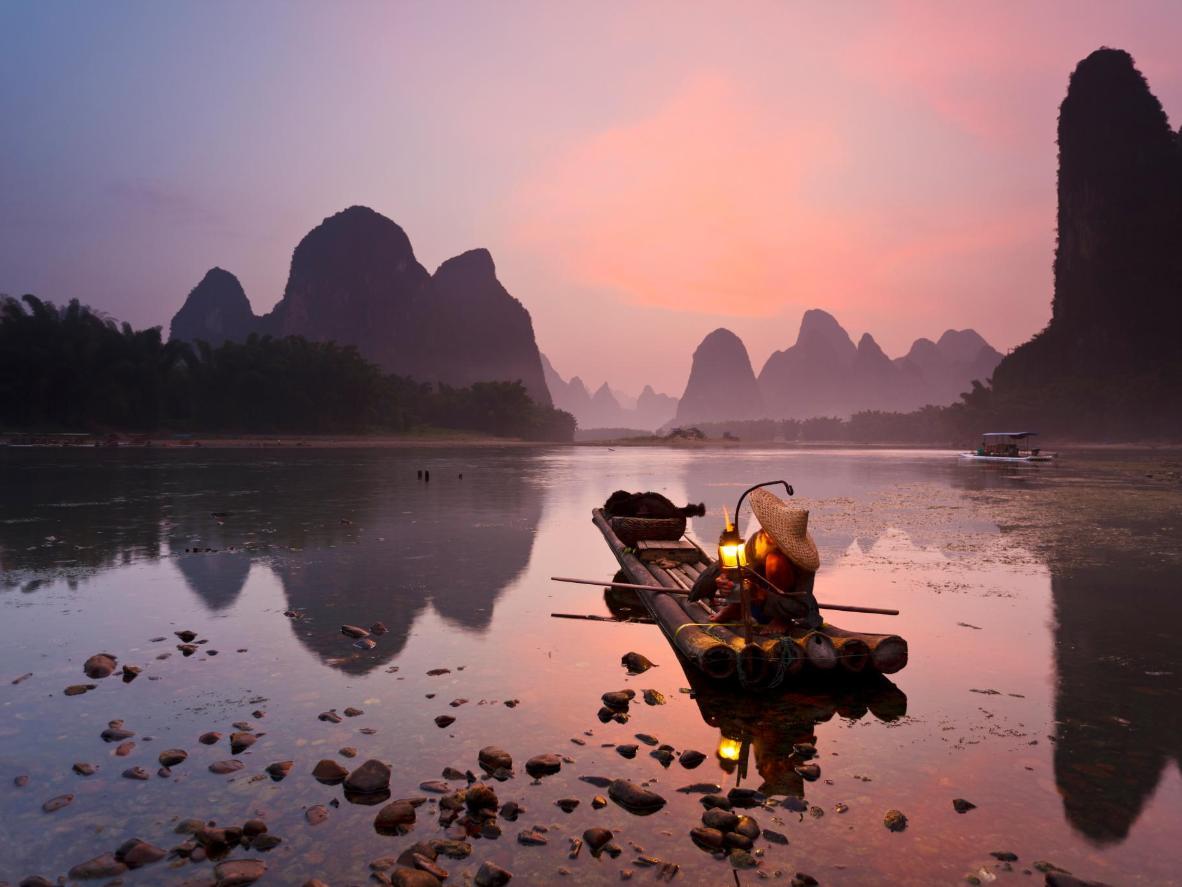 Hop on a bamboo raft to drift down the Li River, near Yángshuò