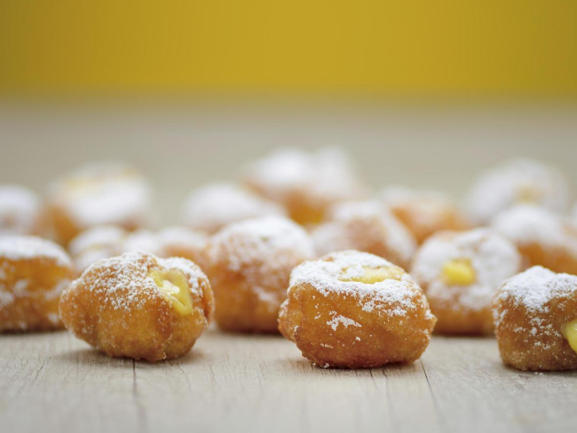 Carnival treats of fruit and sweet dough masked in batter