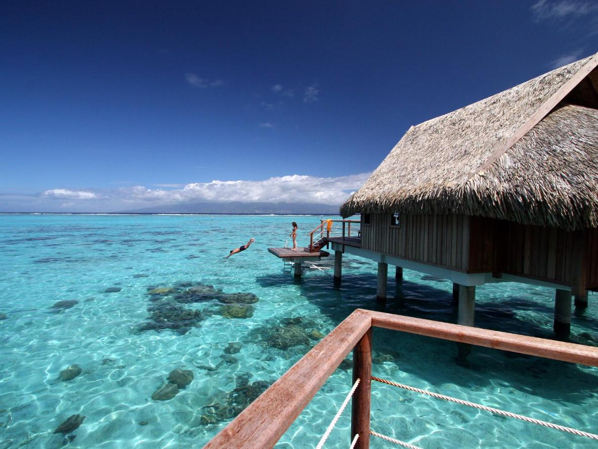 Crystal-clear waters surround the private bungalow