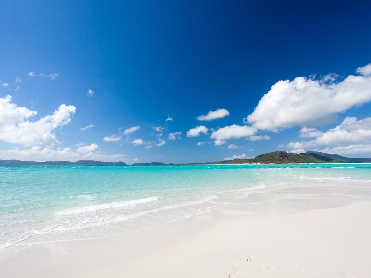 Arrive by plane to experience the beauty of coming in to land over blazingly-bright blue sea and white sand