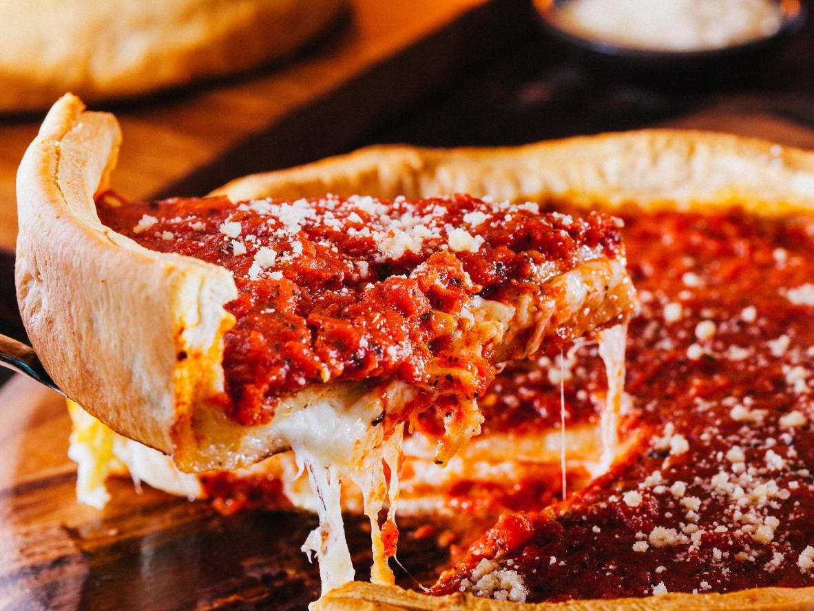 Deep dish is all about textures – crispy crust, juicy tomatoes, and gooey cheese