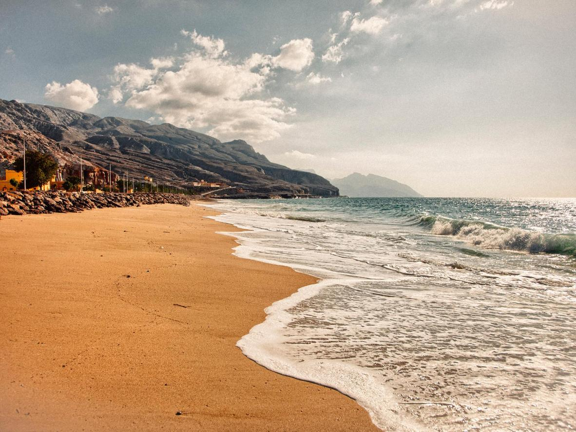 The Musandam mountains provide a dramatic backdrop to this immaculate, sandy beach