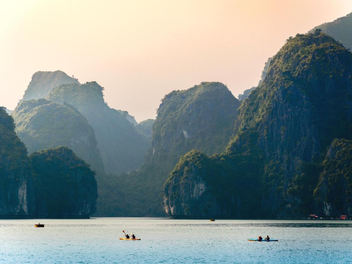 Kayak jade waters around Cat Ba Island