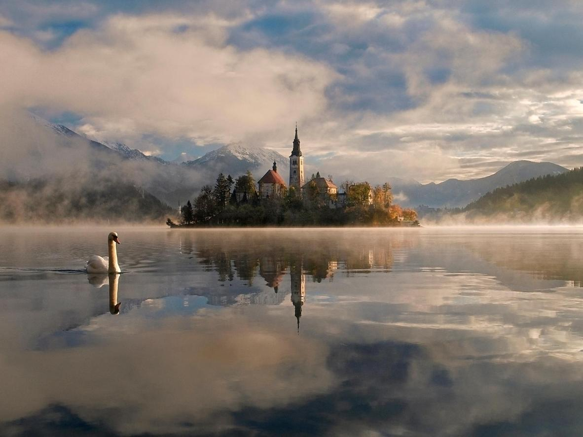 Take a boat trip around ethereal Lake Bled
