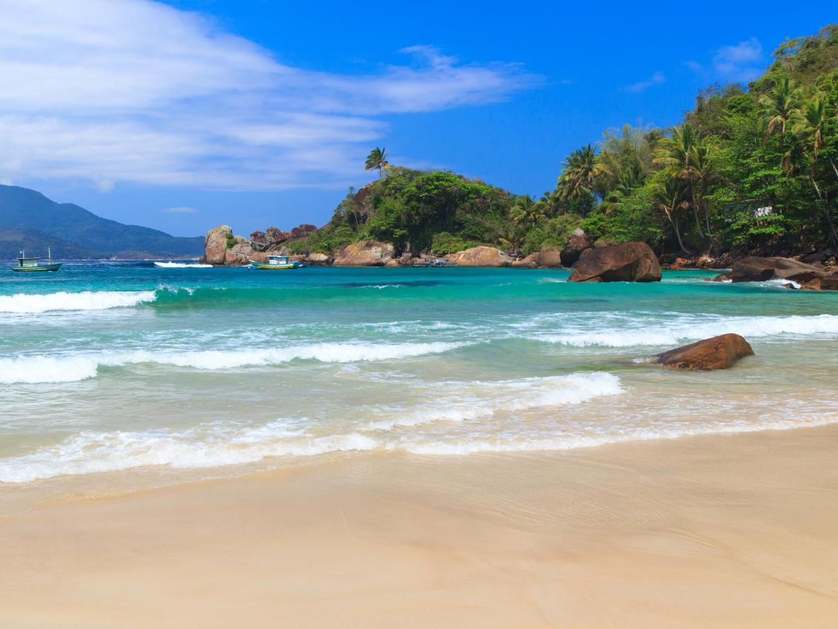 Secluded Praia de Aventureiro is popular with surfers for its rippling tide