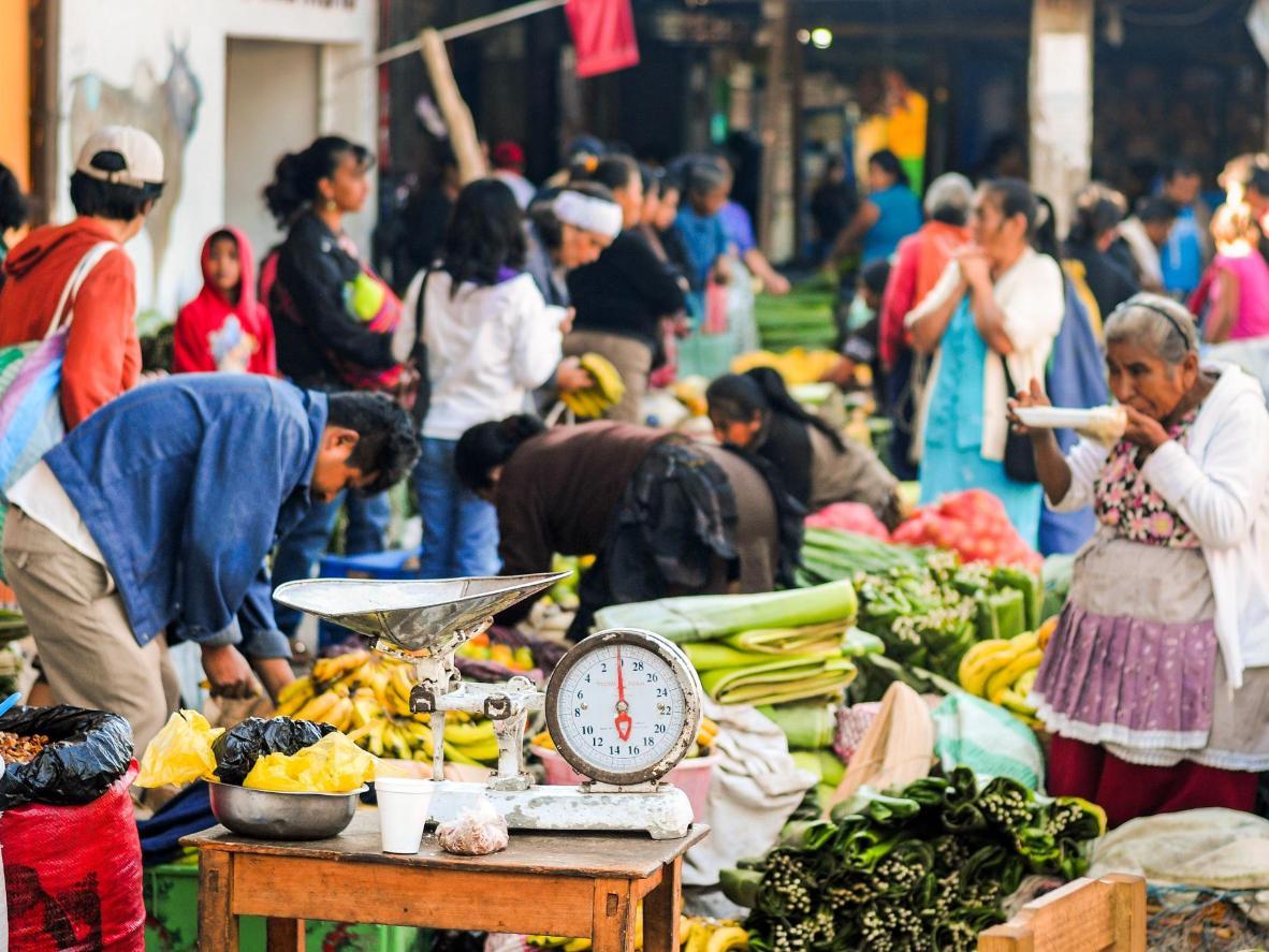 A customer samples the produce at the Antigua Guatemala Mercado