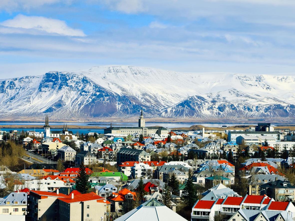 As the snow on Mount Esja recedes, colour returns to the city