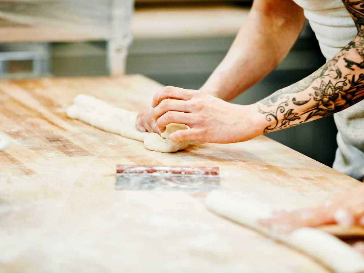 A baker shaping dough in Hartford