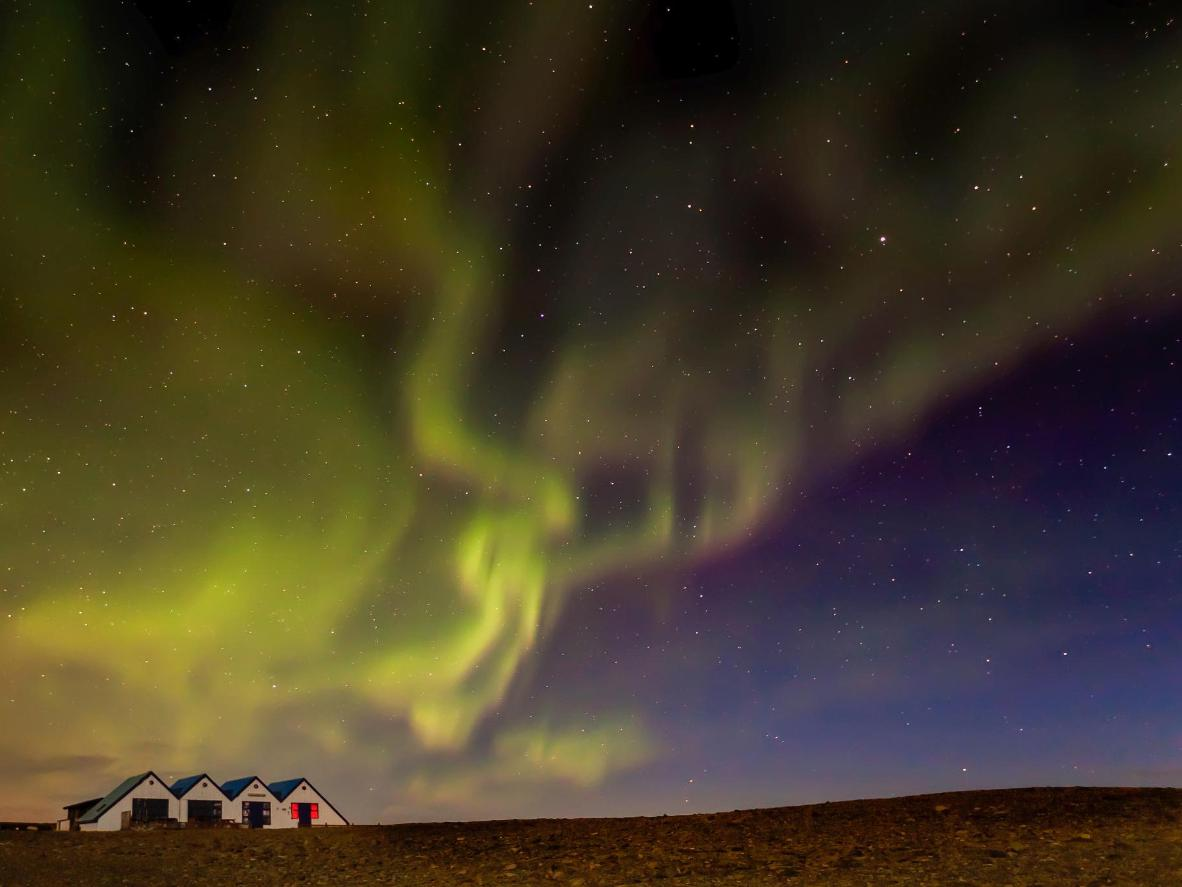 Watch the Northern Lights stream across the sky from the tiny hamlet of Kálfafell