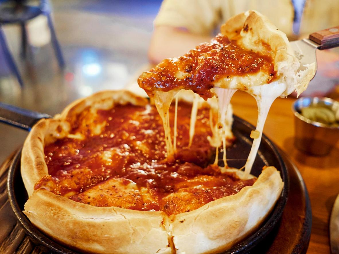 A Margharita deep-dish pie is filled with melted mozarella