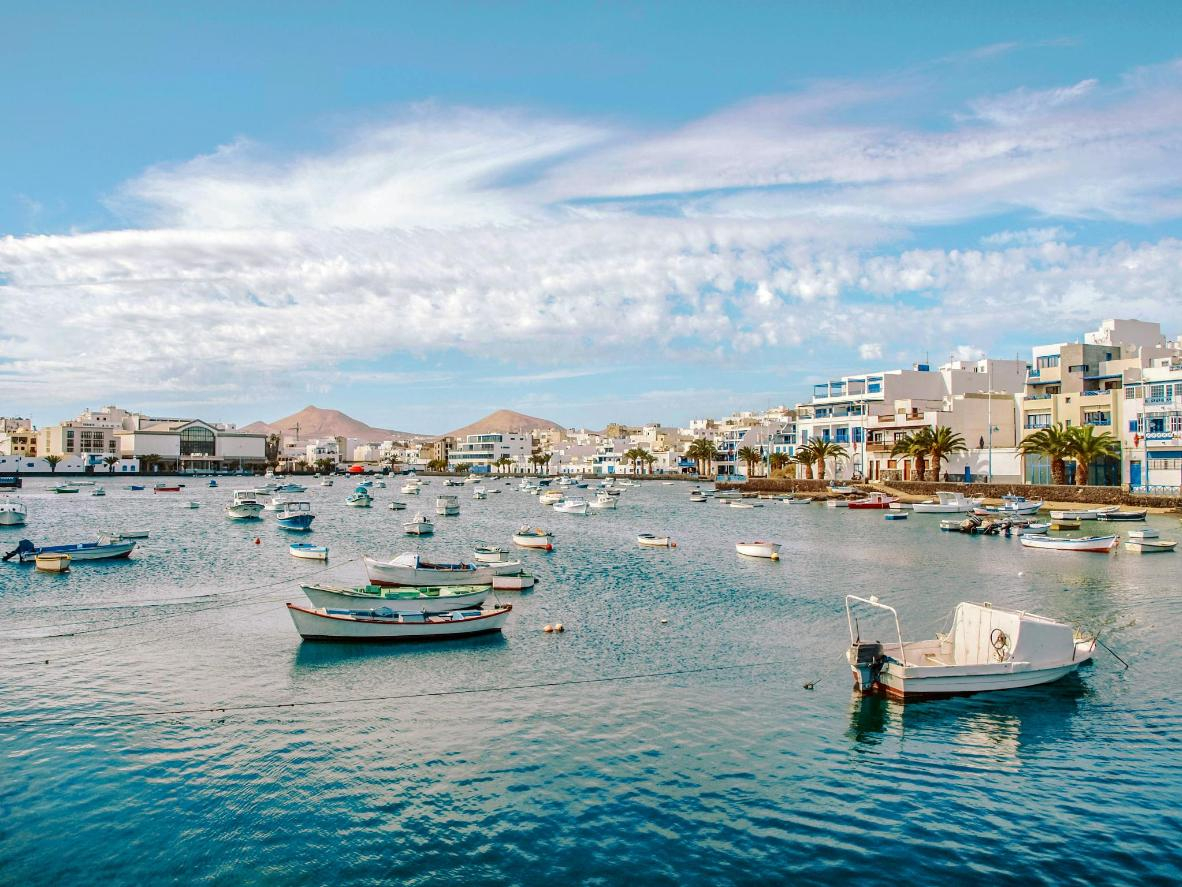 Lanzarote harbour is a pretty constellation of fishing boats and azure waters