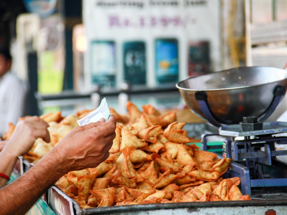 Lamb samosas on sale at a stand-and-eat food stand