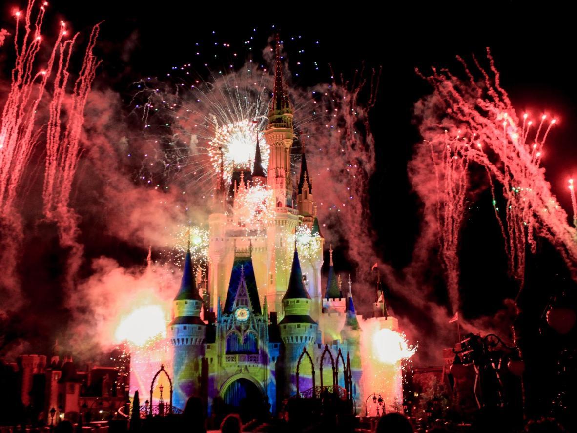 Recreate a fairy tale during the fireworks display at Cinderella Castle, Disney World Magic Kingdom