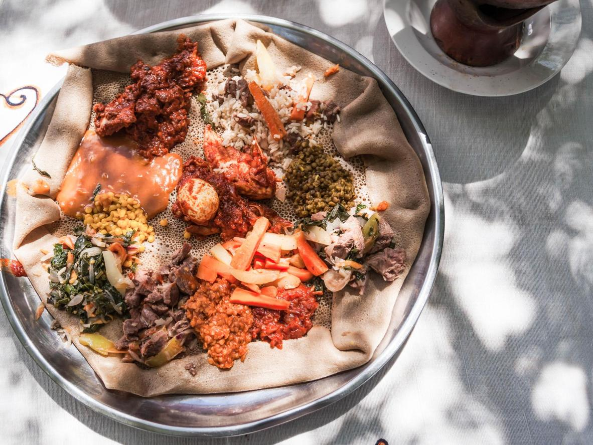 Injera topped with wat