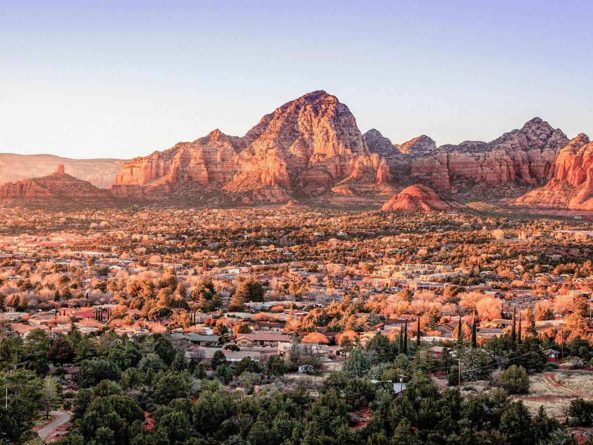 Follow hiking trails through red rock canyons and scented pine forests in Arizona