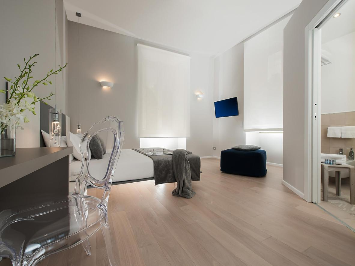 Mood lighting, wood floors and stylish touches create a luxurious feel at Colosseum Corner