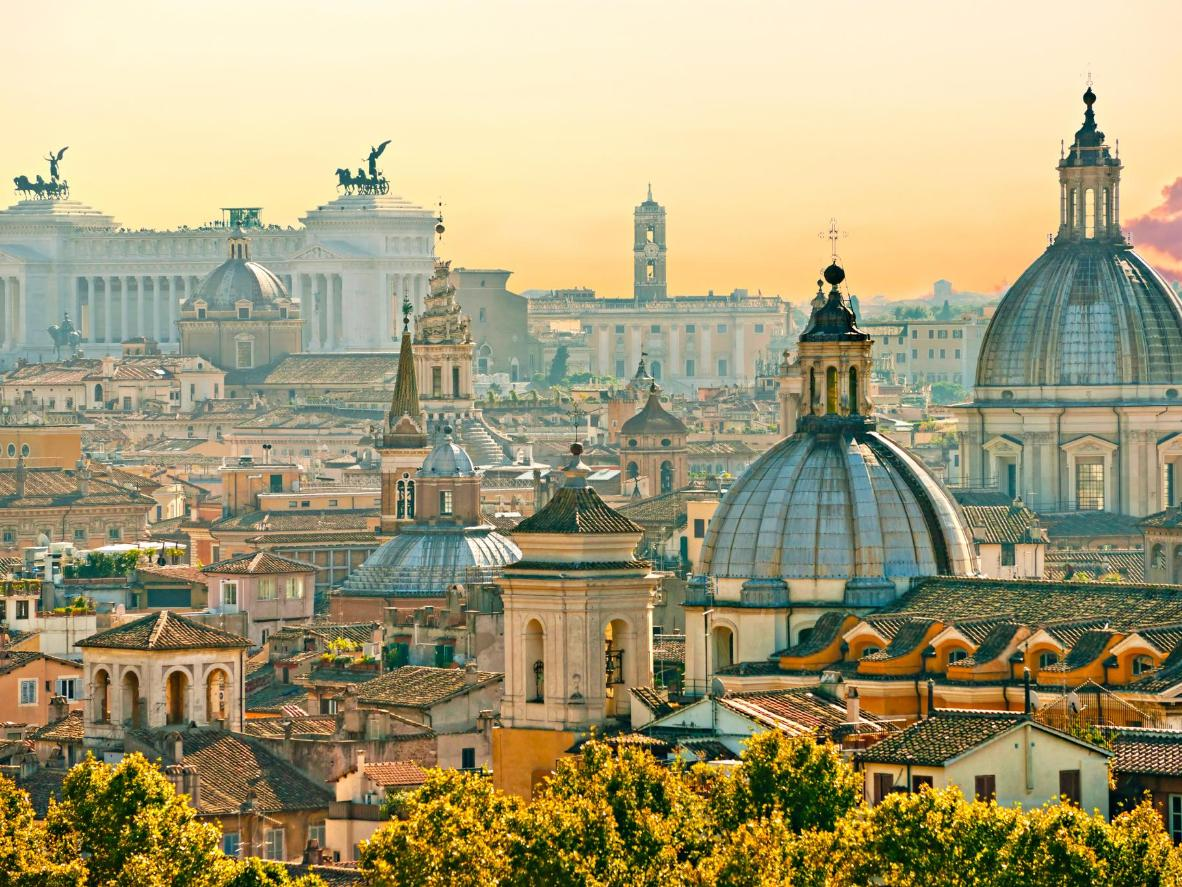 Rome's ancient rooftops at sunset