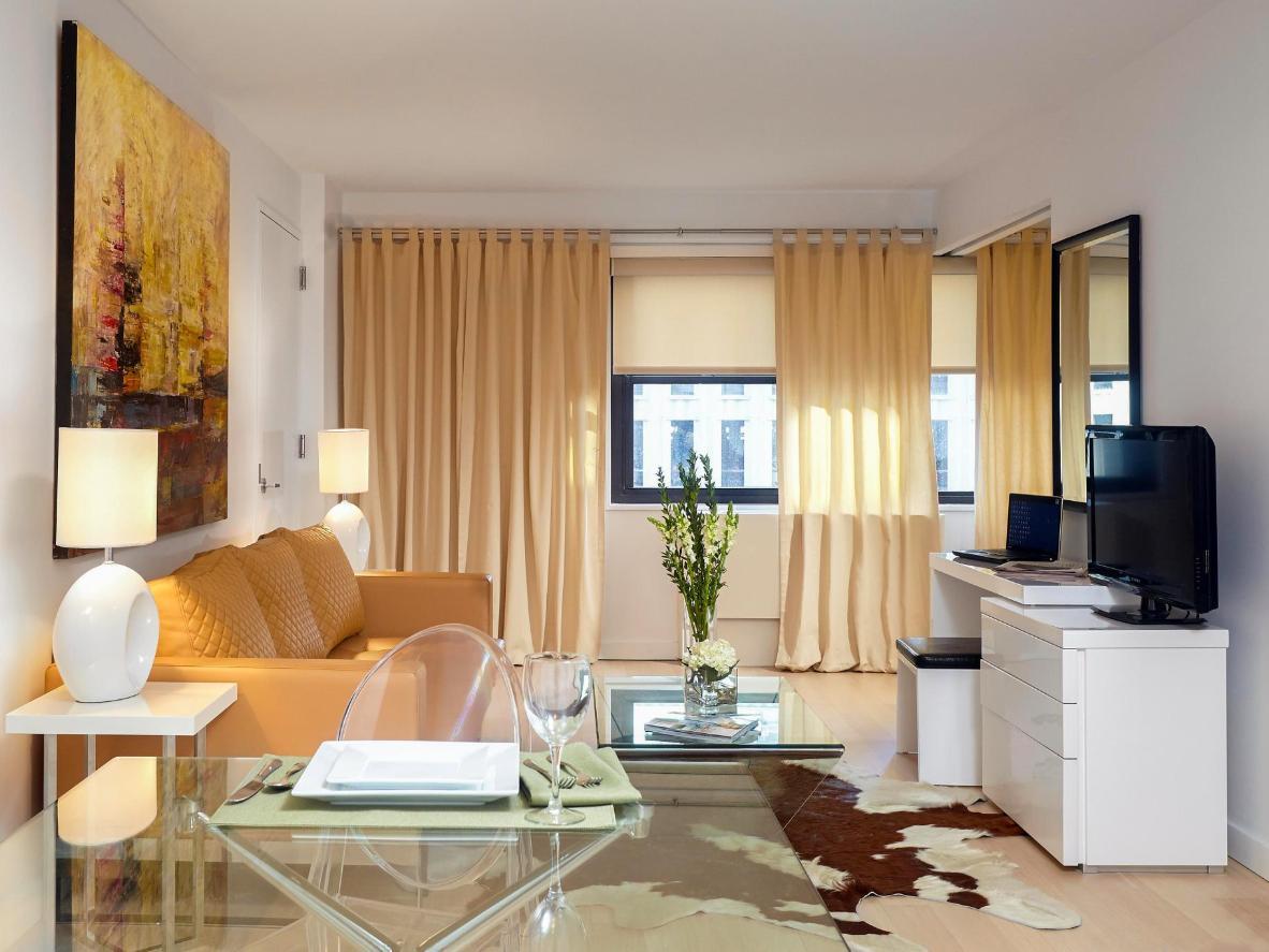 Fresh flowers and glass furniture create a sense of calm
