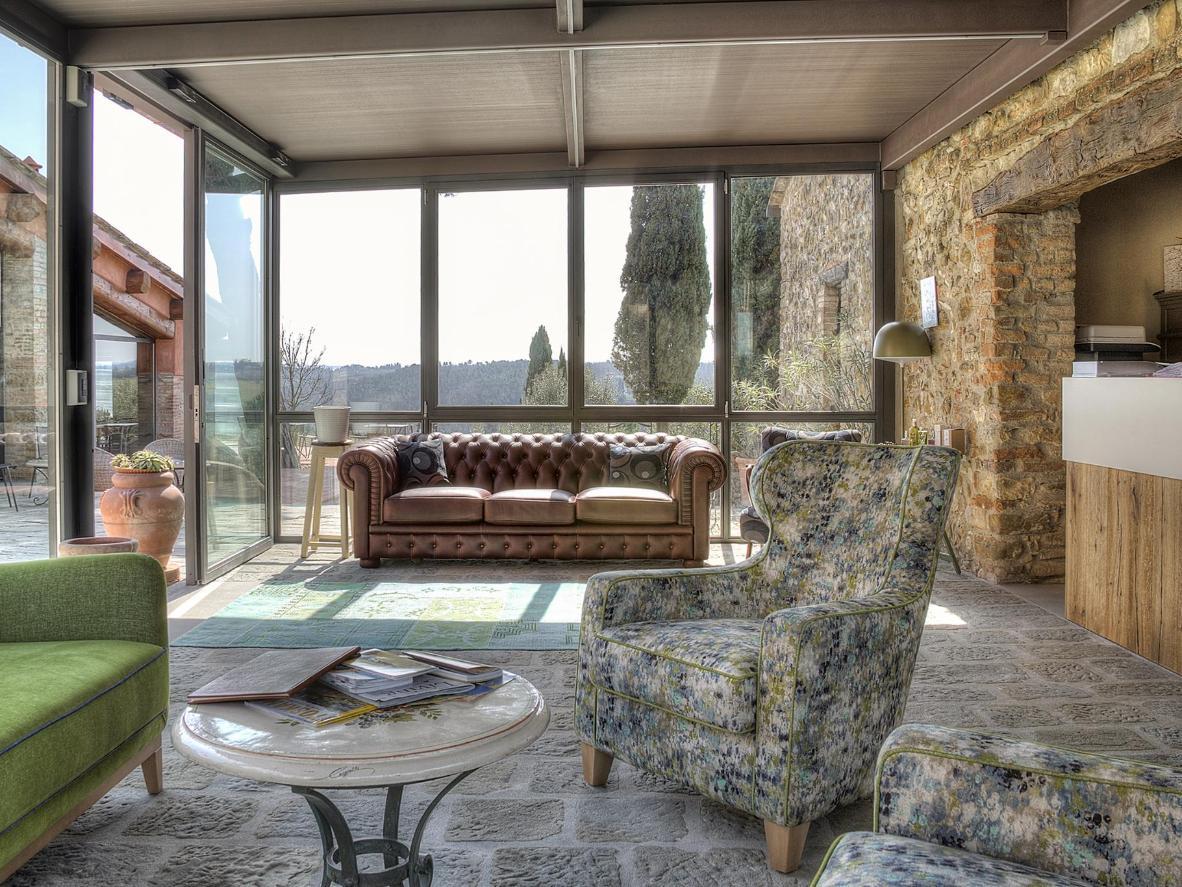 Floor-to-ceiling windows showcase the lush scenery