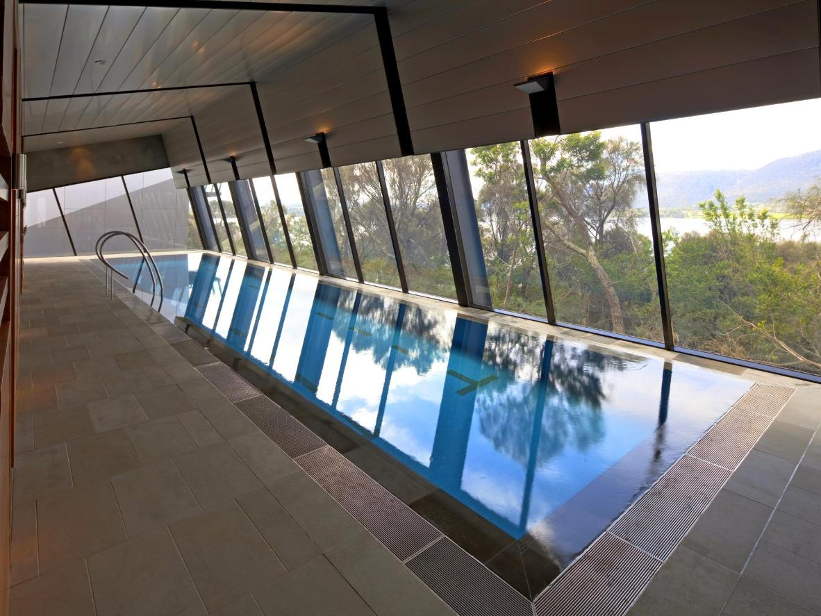 Gaze out at the snaking, silver gum tree-lined Derwent River from the MONA Pavilions pool
