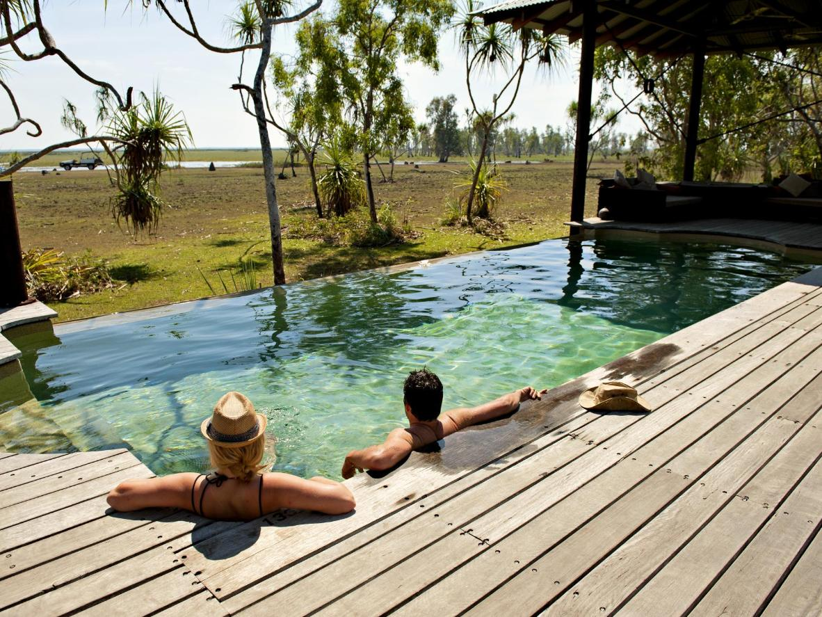 Watch buffalo and dingoes graze in the Outback from this remote infinity pool