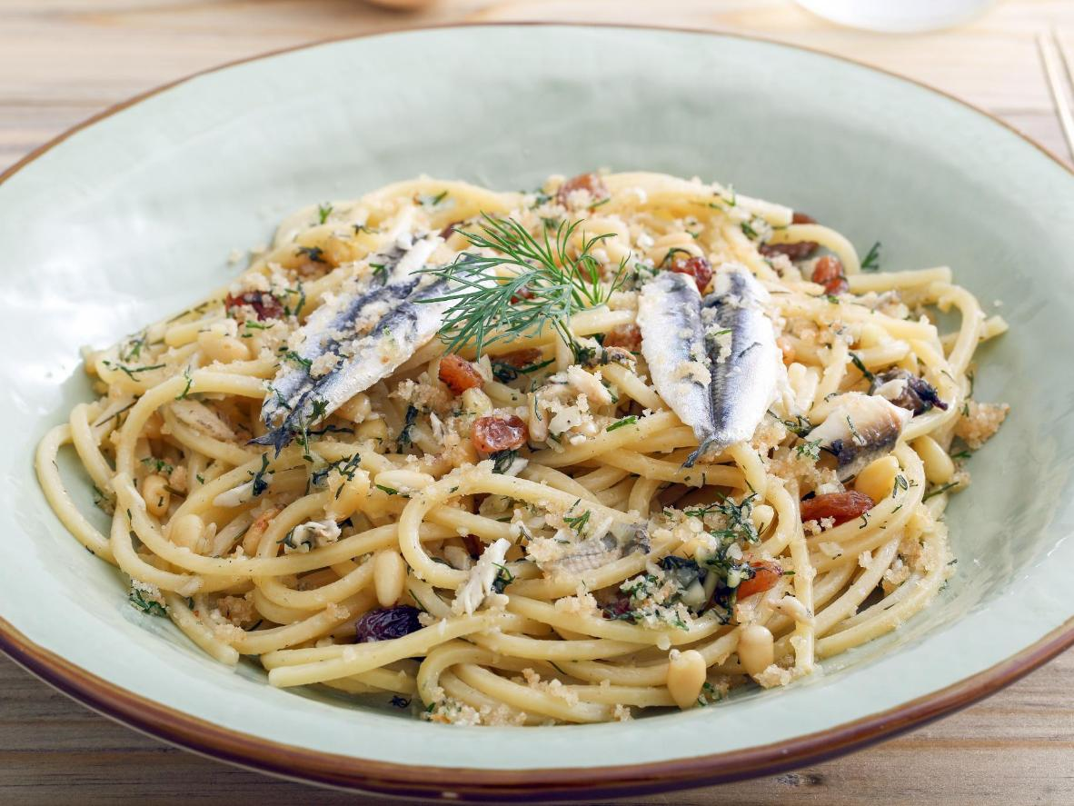 Salty sardines and sweet raisins combine for a perfectly balanced taste