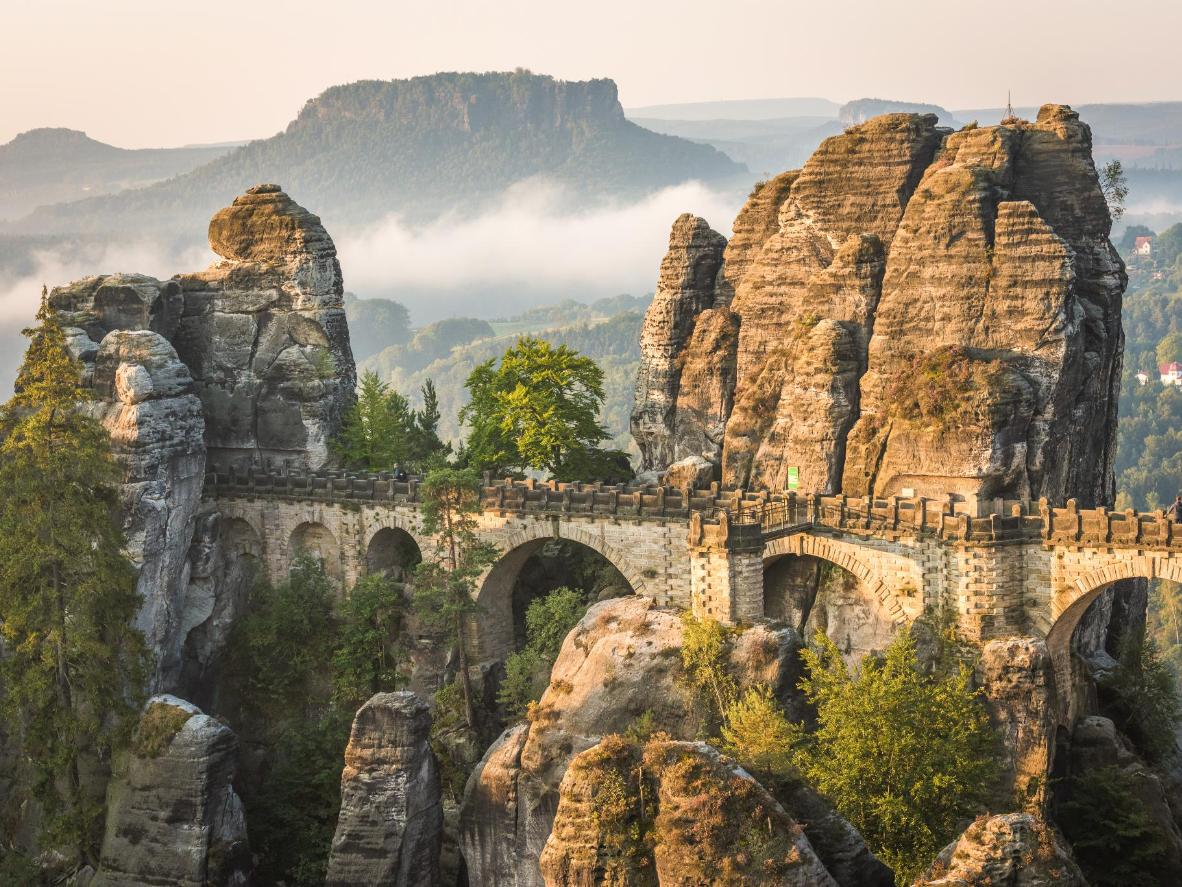 From Lohmen, hike up to the Bastei, a mysterious rock formation that looms over the Elbe River