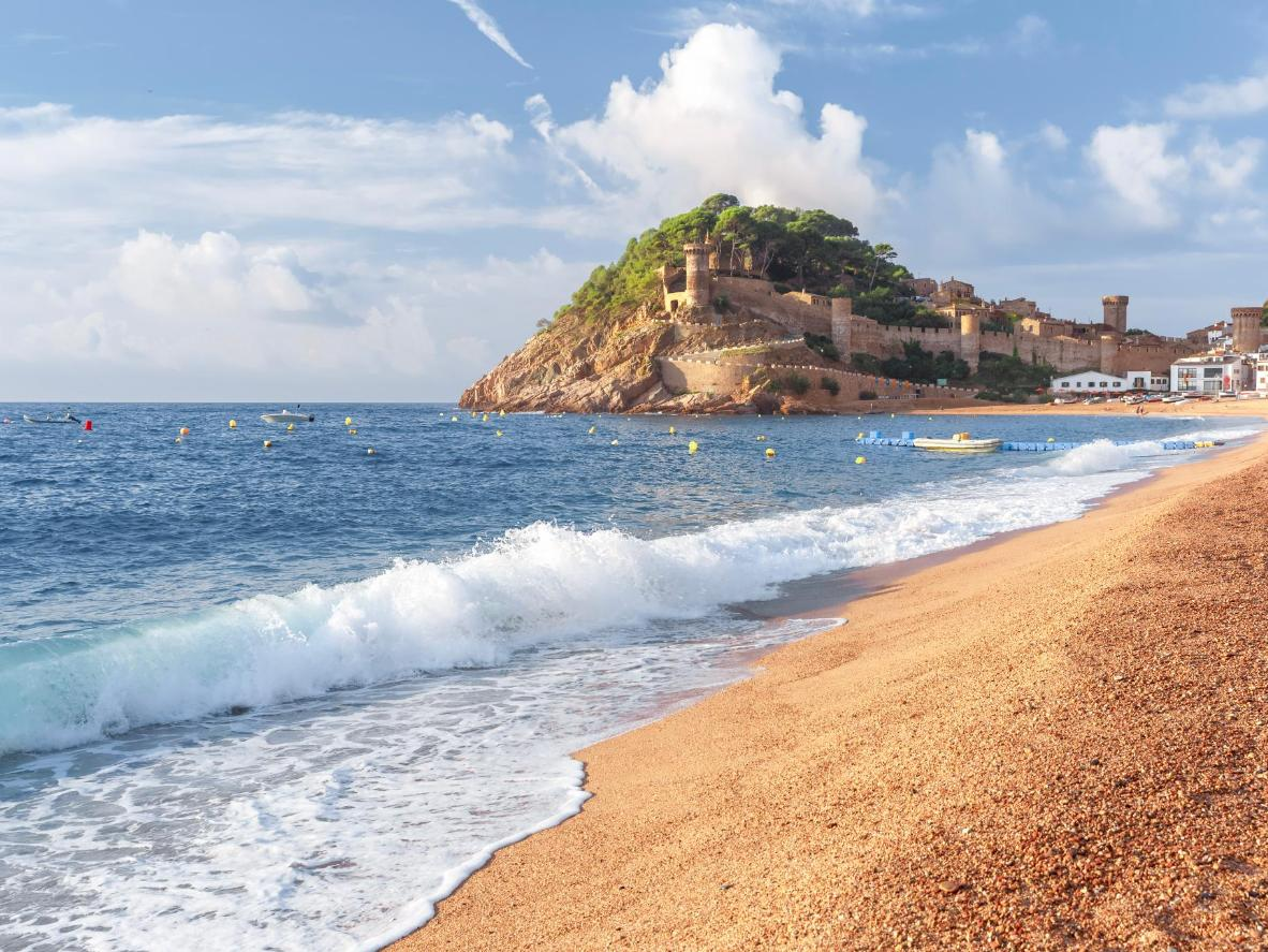 Head down to Platja Gran beach in Tossa de Mar for castle views