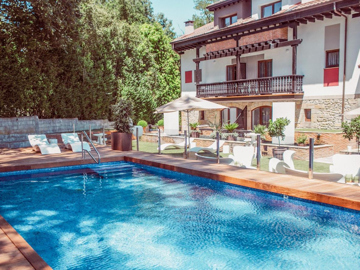 The whole family can relax in the dappled shade of Hotel Cuevas' pretty garden