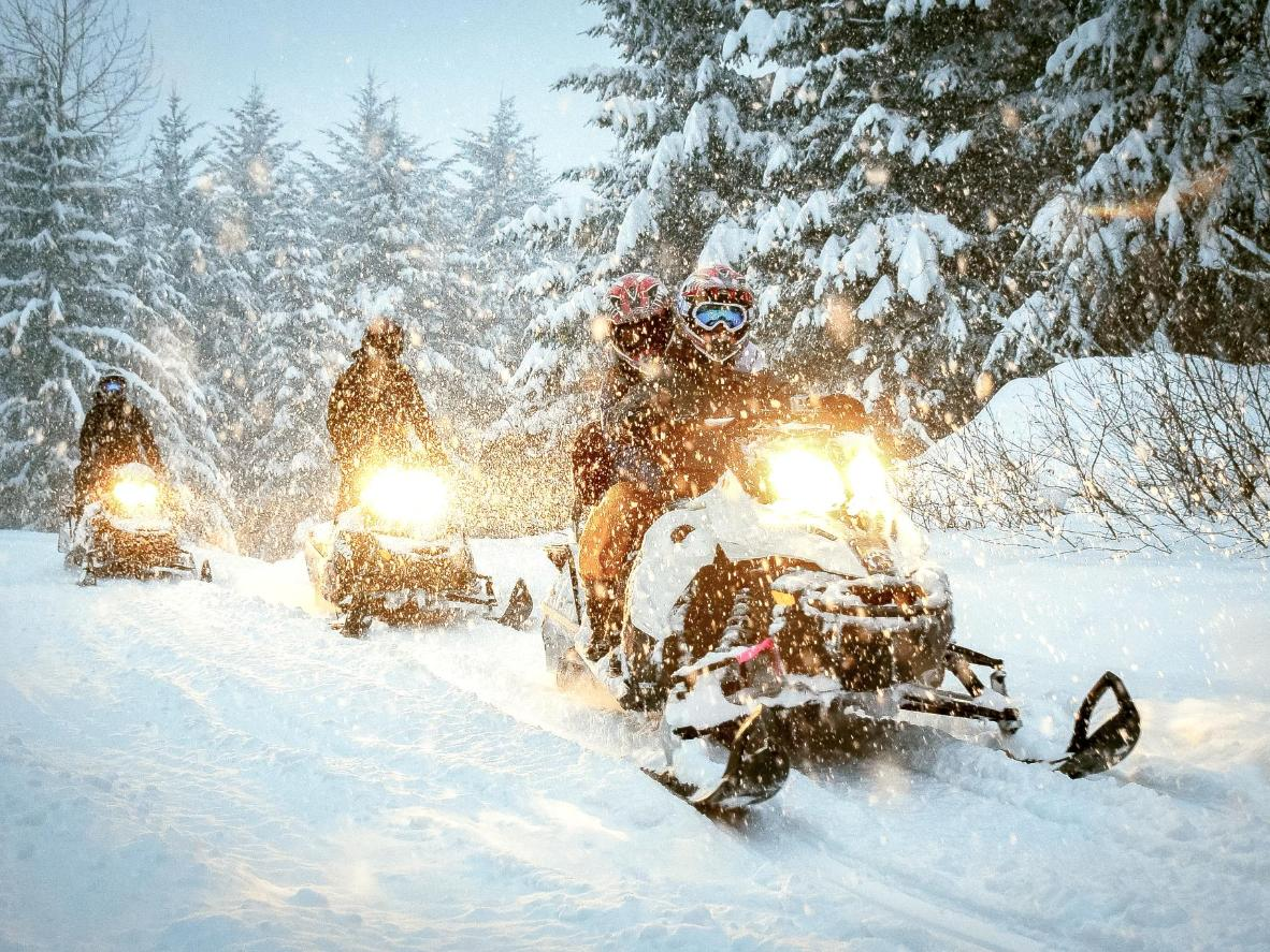 Ski, snowboard or hop on a snowmobile together in Whistler