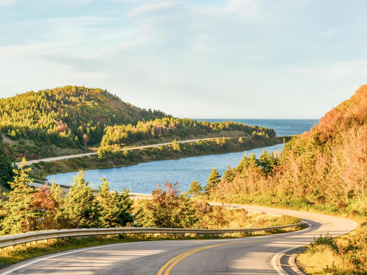 Witness vistas of dense forests, mountains, valleys, lakes and plateaus on the Cabot Trail