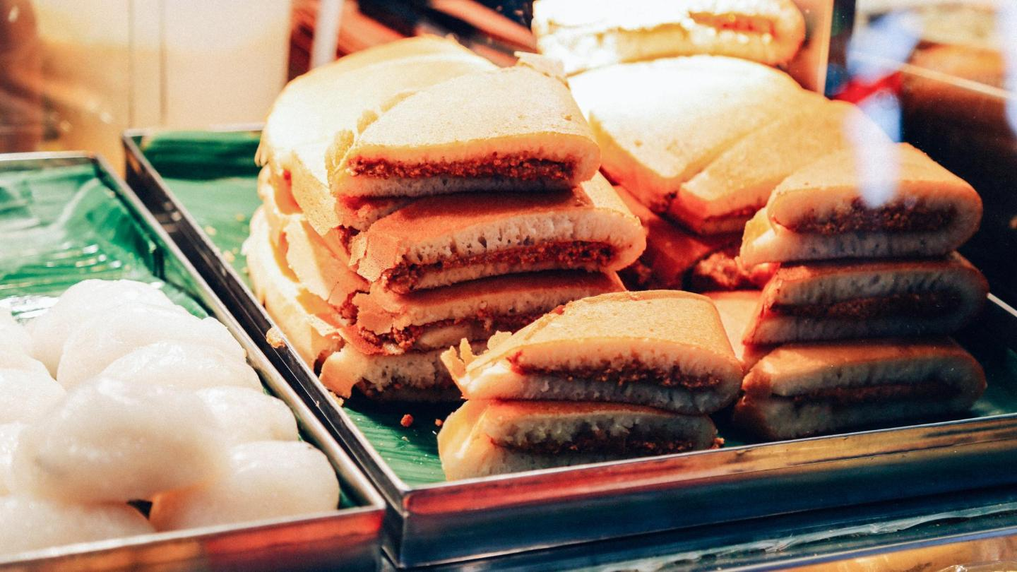 Fluffy pancakes, folded and generously stuffed with a sugary peanut filling