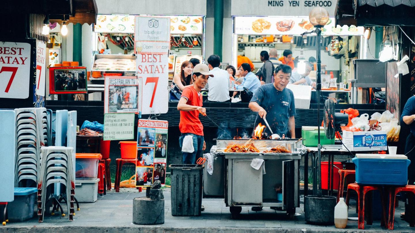 The satay street – a row of stalls selling skewered chicken, lamb, beef, and pork