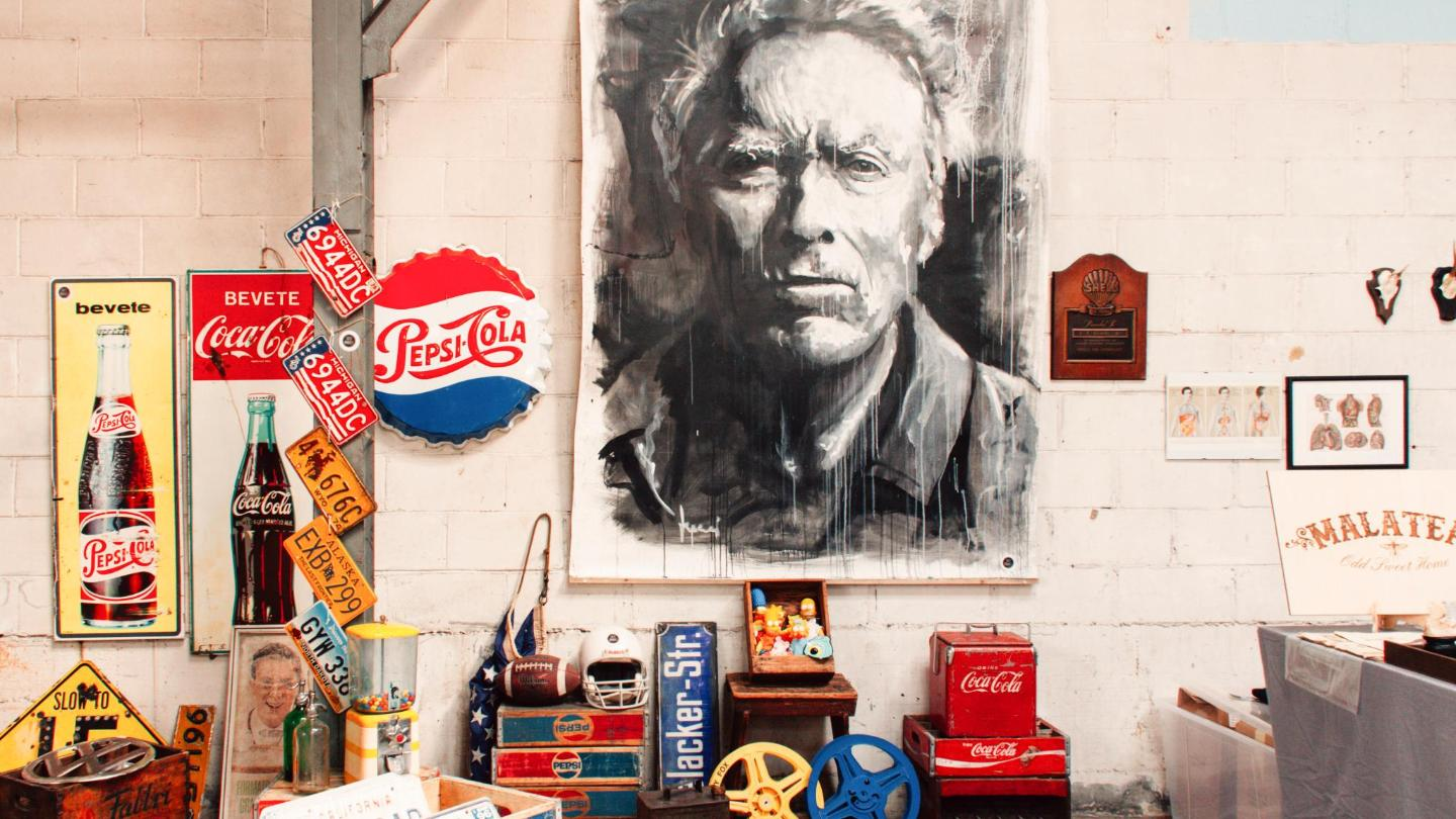 Vintage soda signs, a Simpsons statue, and a haunting painting