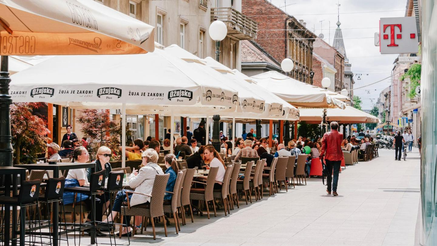 Locals gather on the terraces of Cvjetni Square for Saturday morning coffee