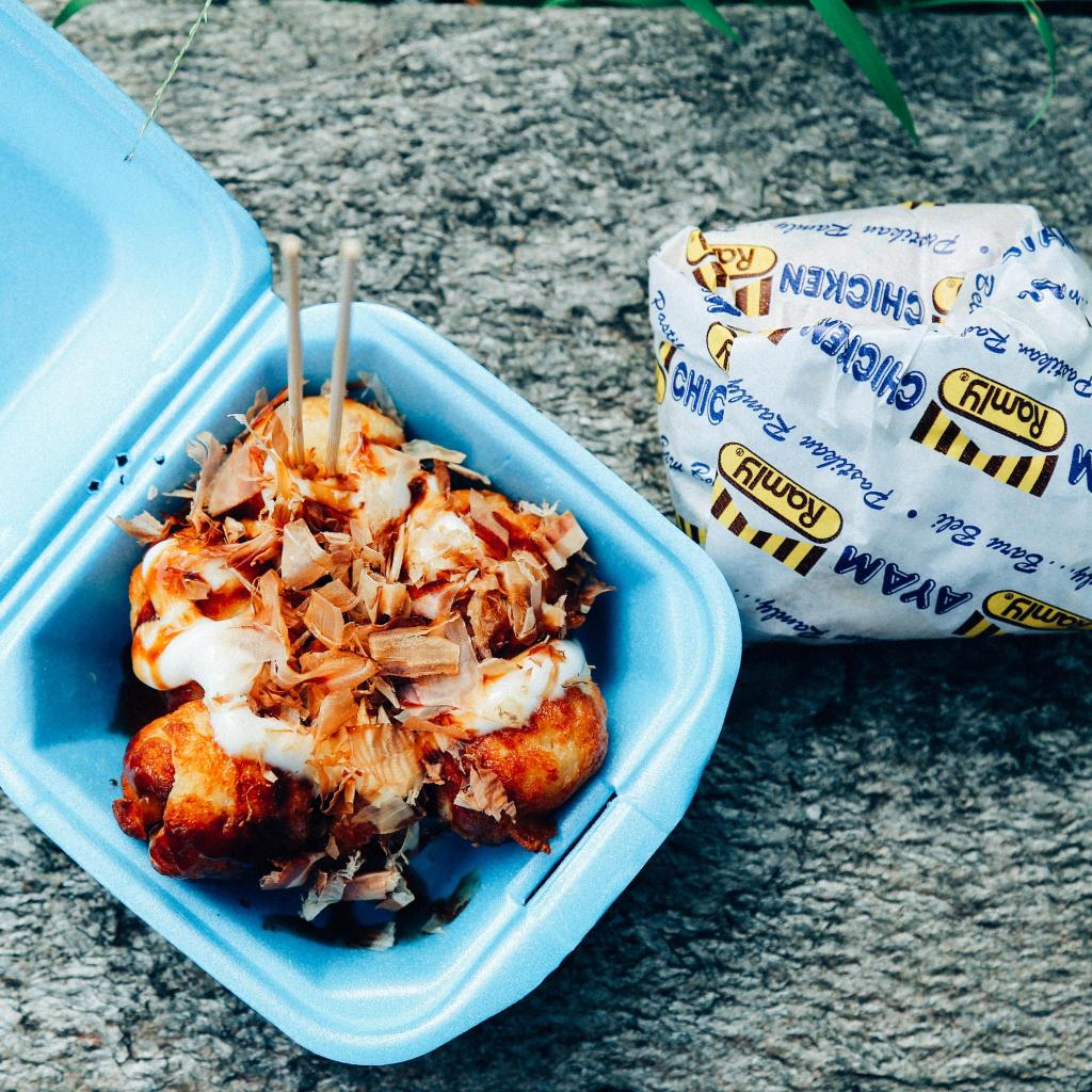 Takoyaki with fish flakes and the Ramly burger are local market favourites