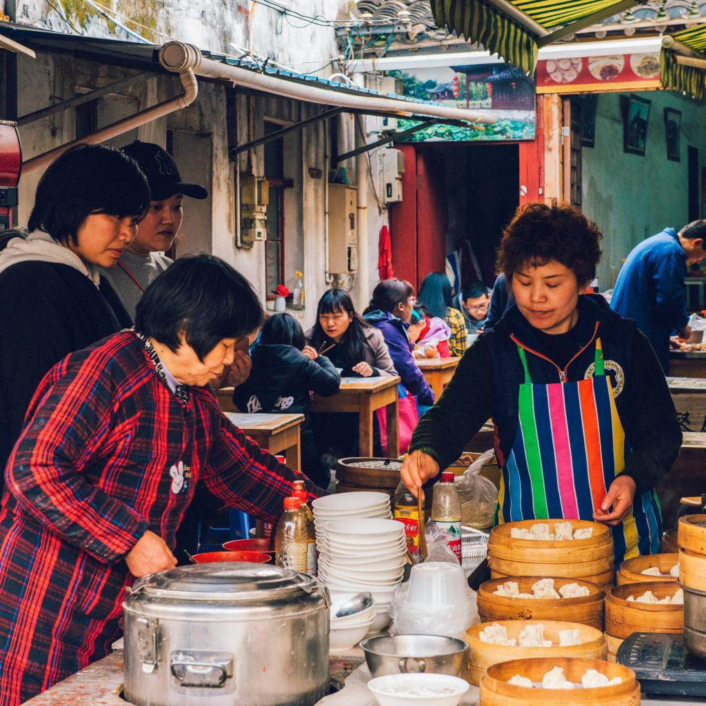 Locals enjoy some steamed baozi (filled Chinese buns)