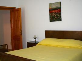 Kennedy Apartments, Scano Montiferro
