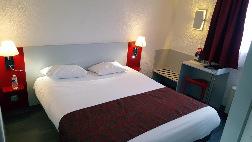 Un ou plusieurs lits dans un hébergement de l'établissement Relais Fasthotel Tarbes-Semeac