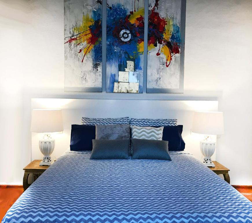 A bed or beds in a room at Privilege Menorca Apartment