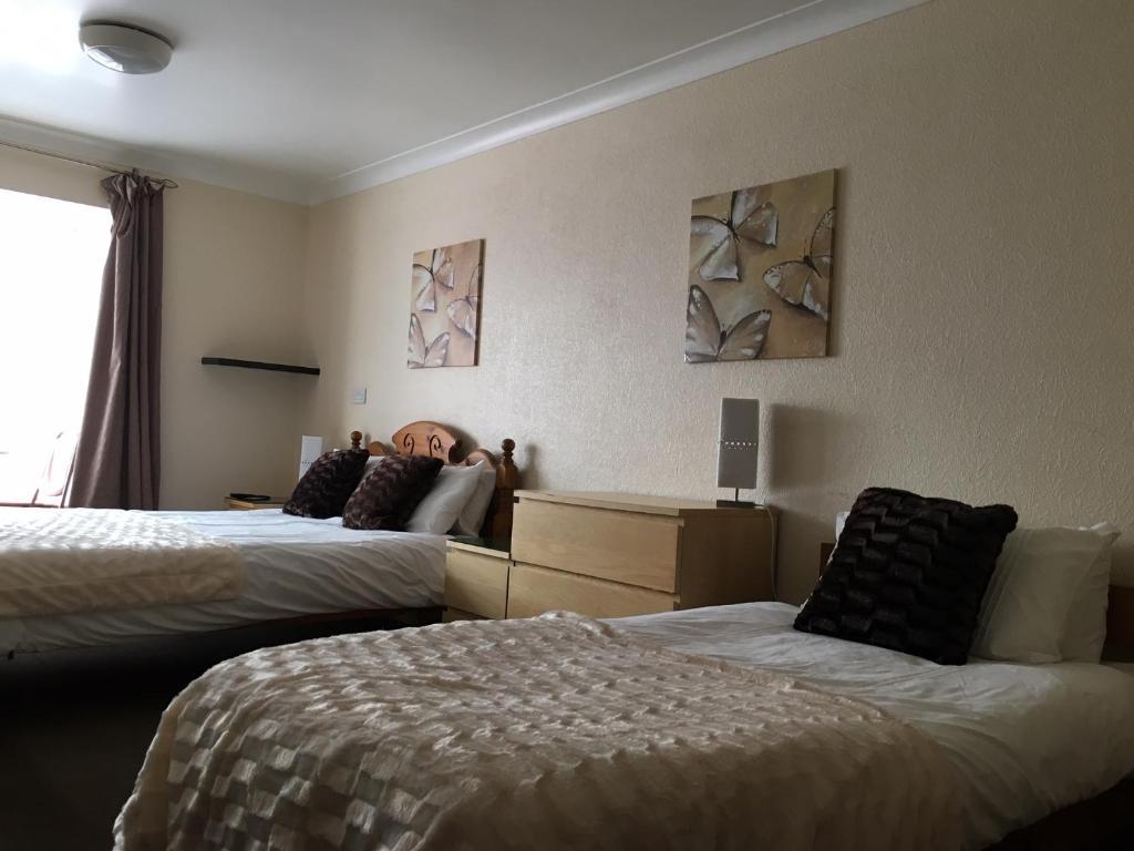 Postel nebo postele na pokoji v ubytování Llanion Lodge