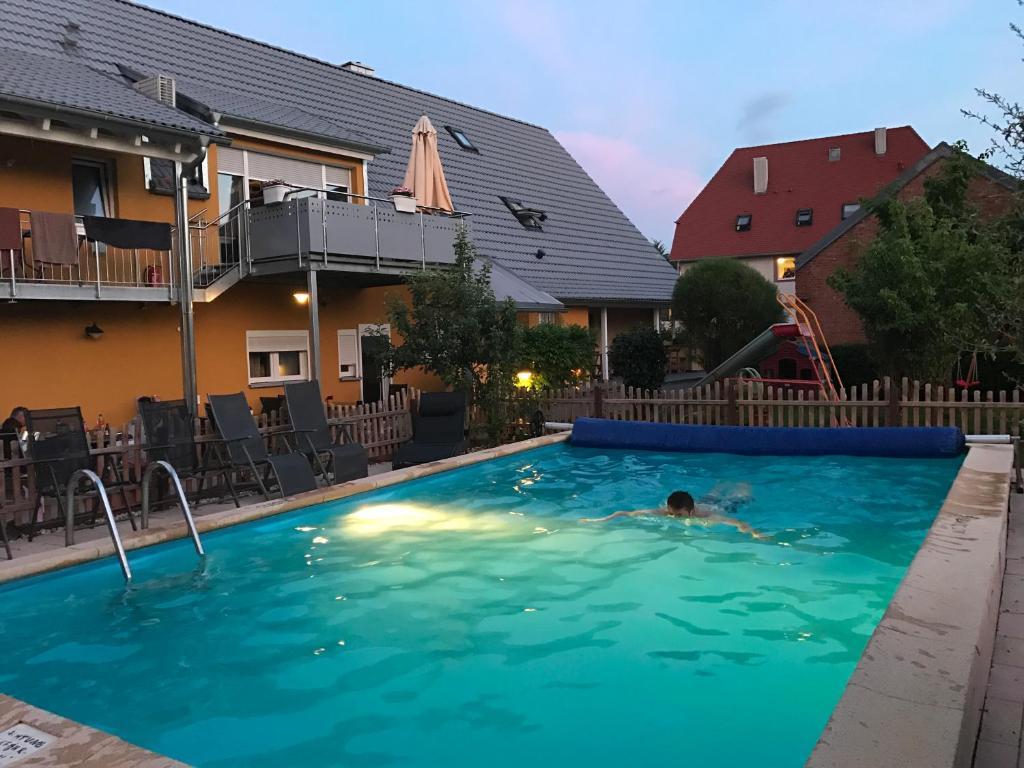 The swimming pool at or near Pension LeLiLa Rust (ex. Gästehaus Milella )