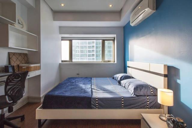 A bed or beds in a room at Corner BGC Suite @Parklane