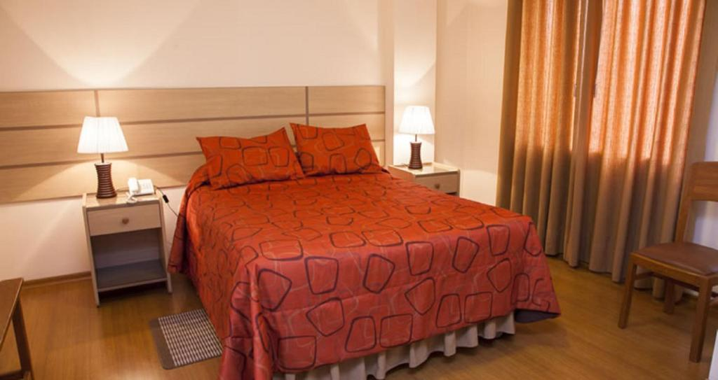 A bed or beds in a room at Gran Hotel Central
