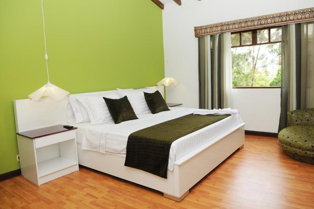 A bed or beds in a room at Kolor Hotel Boutique