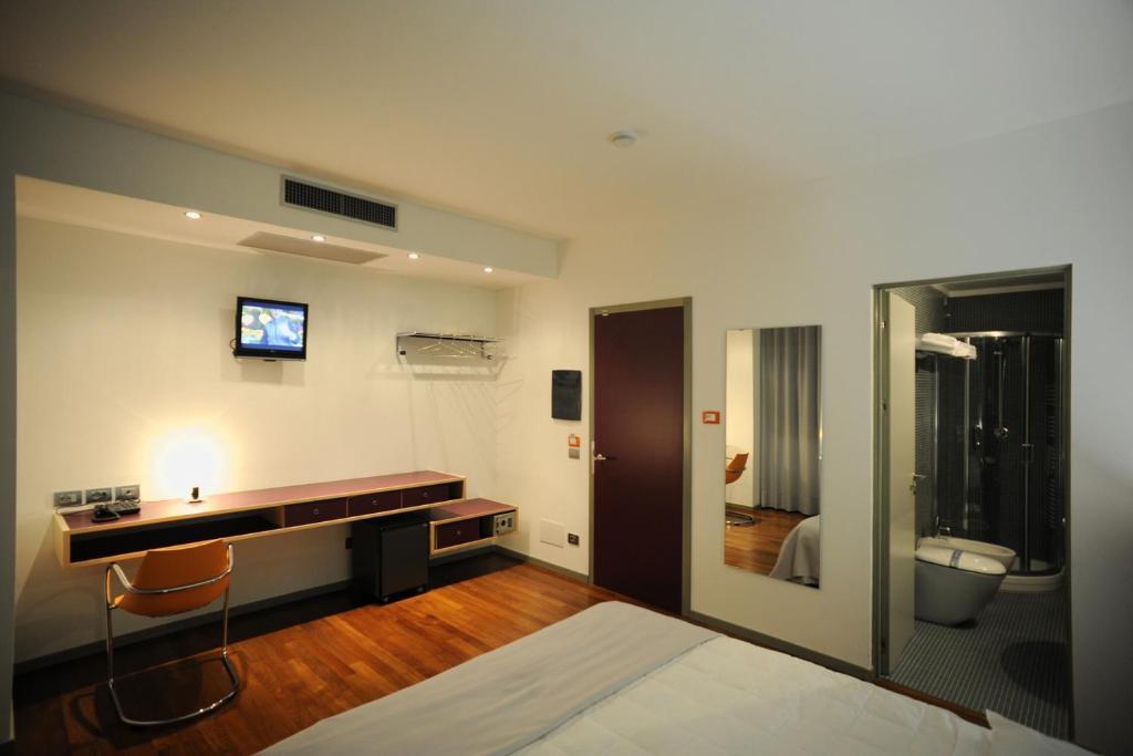 TV a/nebo společenská místnost v ubytování Alloggi Taverna Caorlina