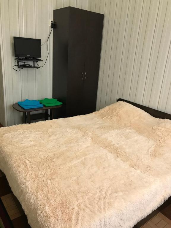 Кровать или кровати в номере Отель Ной