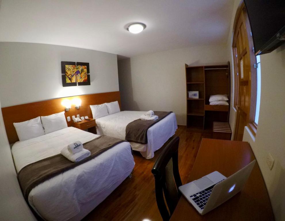 Ліжко або ліжка в номері Casona Plaza Hotel Colonial