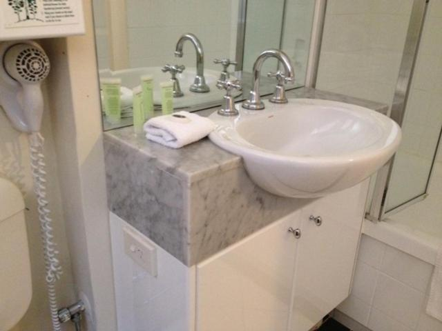 A bathroom at Knightsbridge Apartments